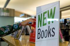Choosing a New Book (aaronrhawkins) Tags: book library public choose reach hand saltlakecity inside shelf display kellie aaronhawkins utah