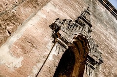 Low angle canted view of arched doorway in Brick temple, Bagan, Burma (jasonrosette) Tags: camerado jrosette jasonrosette asia bagan travel pagoda wat temple religion ancient burma myanmar arch doorway church ruin archtecture