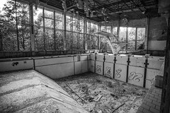 Pripyat Swimming Pool - 11/09/2019 (kevaruka) Tags: chernobyl exclusion zone 911 pripyat dodgems bumper cars bw nuclear disaster urban photography black white ga mask canon eos 5d mk3 ef 1635 f28 mk2 wide angle uwa ultra ukraine 5d3 5diii doll gas dof depth people photoadd television flickr front page kevin frost composition colour colours color colors contrast school september 2019 11092019 indoor