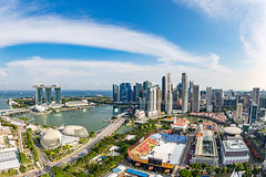 Panorama image of the skyscrapers in the city center of Singapore, around Marina Bay, at daytime. (baddoguy) Tags: ancient civilization architecture backgrounds blue building exterior built structure business finance industry capital cities cityscape clarke quay cloud sky color image copy space day downtown district esplanade theater economy financial growth high angle view horizon over land water horizontal july marina bay singapore modern no people old town outdoors panoramic photography skyscraper southeast asia stadium street summer sunny