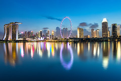 Singapore Skyline (cityscape) Waterfront around Marina Bay with Reflection in the Water at Dusk. (Twilight - blue hour). (baddoguy) Tags: architecture arts culture entertainment backgrounds blue built structure capital cities city street cityscape color image complexity copy space cross section design development diminishing perspective downtown district dusk famous place finance economy horizon over water horizontal igniting illuminated international landmark long exposure majestic marina bay singapore sands modern multi colored night no people office building exterior outdoors panoramic photography point view promenade reflection lake road seascape skyscraper tranquility travel destinations twilight urban skyline waterfront