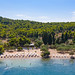 A view from the sea of Zogeria Beach on Spetses, Greece