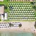 Top-down aerial of the private beach of AKS Hinitsa Bay Resort in Porto Heli, Greece