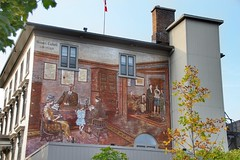 Brockville Ontario - Canada -  Stewart Corbett Law Offices Mural (Onasill ~ Bill Badzo) Tags: canon sl 1 macro sigma lens 18250mm mural brockville on ontario canada stewart corbett law offices stucco heritage building 21 court street office masonry ave family young child desk clients large attraction painting blue sky historic tourist walking tour travel onasill tree architecture