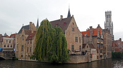 I like the attention from tourist, I wave while drinking here. (Brian James Manson) Tags: brugge belgium buildings bruggebuildings canals waterways