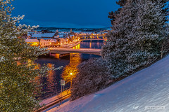 """Christmas-time, 2009. Snow-covered Inverness and the River Ness, from the Castle Ramparts. (Scotland by NJC.) Tags: snow blizzard snowstorm sleet snowdrift snowflake flurry ثَلْج neve 雪 snijeg sníh sne sneeuw nieve lumi neige schnee χιόνι 눈 snø sunrise dawn daybreak sunup morning daylight شُروقُ الشَّمْس """"nascer do sol"""" 日出 solopgang zonsopgang amanecer auringonnousu """"lever du soleil"""" sonnenaufgang alba 日の出 river stream waterway tributary brook canal watercourse creek beck burn rijeka řeka flod rivier fleuve fluss fiume 강 흐르는 물 elv town pueblo by stadt dorf cittadina cittadino inverness christmas riverness scotland"""