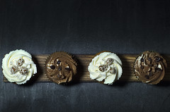 Lighted cupcakes on a wooden board against a black background.  More photos by the link:  https://peterpikephotography.top/cupcakes-on-the-shelf   #background #baked #bakery #birthday #black #board #cake #cakes #celebrate #celebration #chocolate #closeup (Peter_Pike) Tags: treat decorated view white cake unhealthy wood cakes bakery celebrate seeds cream delicious frosting muffin cupcakes celebration closeup light nuts background baked sesame tasty sugar party chocolate cup object birthday confectionery cute holiday top dark sprinkles topping table festive black food home pastry swirl dessert wooden sweet muffins board cupcakecupcakecupcakesbackgroundbirthdaycakecupchocolatefooddessertpartysweetcreamwhitehomedeliciousfrostingbakedcakeswoodendecoratedtastysugartreatcelebrationtableunhealthytopcuteviewswirlcelebratemuffinsmuffinsprinkles