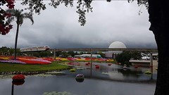 Epcot Orlando (debbie6477) Tags: epcot disney themepark monorail lake flowers palmtrees spaceshipearth cloudy storm