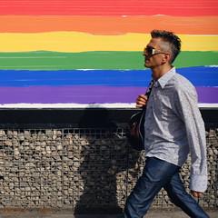 Rainbow Walk (JeffStewartPhotos) Tags: utata thursdaywalk thursdaywalks number700 700ththursdaywalk thursdaywalk700 pedestrian walk walker rainbow man male blur blurred moving onthego square yongestreet toronto ontario canada utata:project=tw700