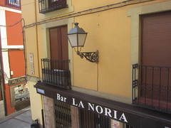 View from my room, looking to the right (d.kevan) Tags: view bar foodshop shopwindow balconies streetlamps buildings calleplegarias leon spain windows blinds window bars name lanoria