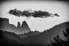 Sad to say Good Bye... (Ody on the mount) Tags: anlässe berge blackwhite dolomiten em5ii filmkorn fototour gipfel himmel omd olympus schlern südtirol urlaub wolken bw blackandwhite clouds dark grain monochrome mood mountains sw schwarzweis sky