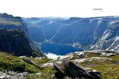 Hike to the Trolltunga  28 km at the moment for this hike, before it was shorter but the made a new road, first 4 km were beofre 1,5 and if you want you can take the Shuttlebus, I walked with my kids whole trail. (Tommysfotografie) Tags: panoramabild panoramaview panorama overview wanderung scandinavia trail norway norge summervibes summer highalpinezone alpine highalpine mountains mountain nature naturephoto naturephotography landscapeperfection landscapephoto landscapephotography landscapeview landscape peoplewhohike hikinghobby hiking hardangerfjord hardanger hardangervidda hordaland trolltunga hikingtrail hike