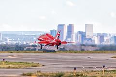 Red Arrow jet taking flight in front of Denver
