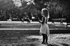 Bubbles (sylvie.trajan) Tags: moody light shadowandlight bw bnw blackandwhitephotography blackandwhite monochrome noiretblanc people childhood sunlight sunset park garden bubbles