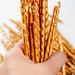 Pretzel sticks close-up in a woman's hand