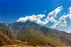 Consequenses Of Throwing Rocks (Alfred Grupstra) Tags: mountain nature landscape scenics outdoors sky hill blue valley asia travel mountainrange summer cloudsky famousplace mountainpeak inca beautyinnature clouds greece athos orosathos
