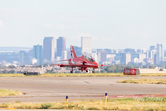 Red Arrow taxiing in front of the Mile High City