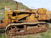 Rust mover (Nekoglyph) Tags: skinningrove cleveland tractor beach rust metal green yellow digger drott cliff caterpillar tracks treads sand cables chimney vent