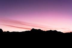 Pink Sky (mylonpruett) Tags: optoutside wanderlust travelmore photography travelphotography zen tranquil relax nature naturephotography outdoors sky landscape pink pinksky mountains silhouette dusk night redrockcanyon redrock nevada vegas landscapephotography sunset vibrant purple oneshot desert
