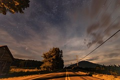 Into the Twilight Zone (Jeff Saly) Tags: sky stars clouds nature landscape yellow nightscape nighttime moonscape canada quebec trees road