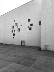 The Church and the Visitor (Rosmarie Voegtli) Tags: krähe vogel bird facade fassade architecture bruderklauskirche birsfelden kunst art blackandwhite diagonal windows fenster concrete