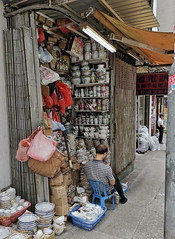 China Shop (cowyeow) Tags: saiyingpun china street chinese asia asian 香港 hongkong city urban composition shop messy old store ceramic ceramics teapot plate bowls kitchenware man