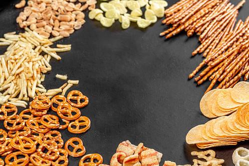 The concept of the Oktoberfest. Frame with beer snacks on black background