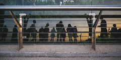 Reflected (Ash and Debris) Tags: glass urbanlife bridge mirror street people reflections city sil citylife streetlife reflection urban silhouette ukraine lines kiev fence sunset kyiv dusk viewmborder