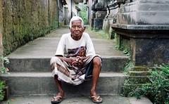 Wise man (mukramin) Tags: panasonic dmcgm1 indonesia bali man old grey asia southeast den pasar penglipuran village bangli regency gianyar penjor bamboo indonesie azie sarong traditional