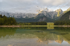 Mountains sunrise III (Branislav Cernic) Tags: sunrise morning daybreak dawn sky clouds fog mountains peaks lake water reflection hills trees grass valley alps italy nature landscape