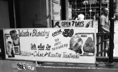 Astor Place Haircutters (neilsonabeel) Tags: nikonfm2 nikon nikkor sign blackandwhite film analogue manhattan newyorkcity street