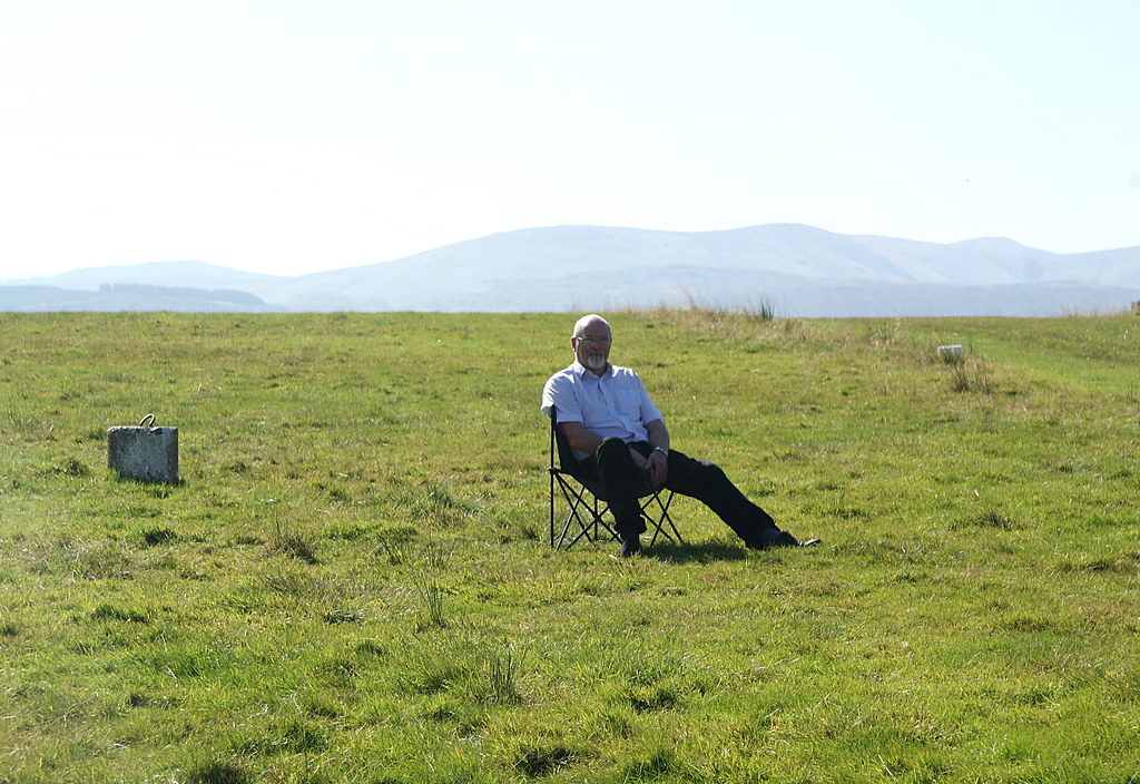 George takes a seat in row A to watch the new arrivals