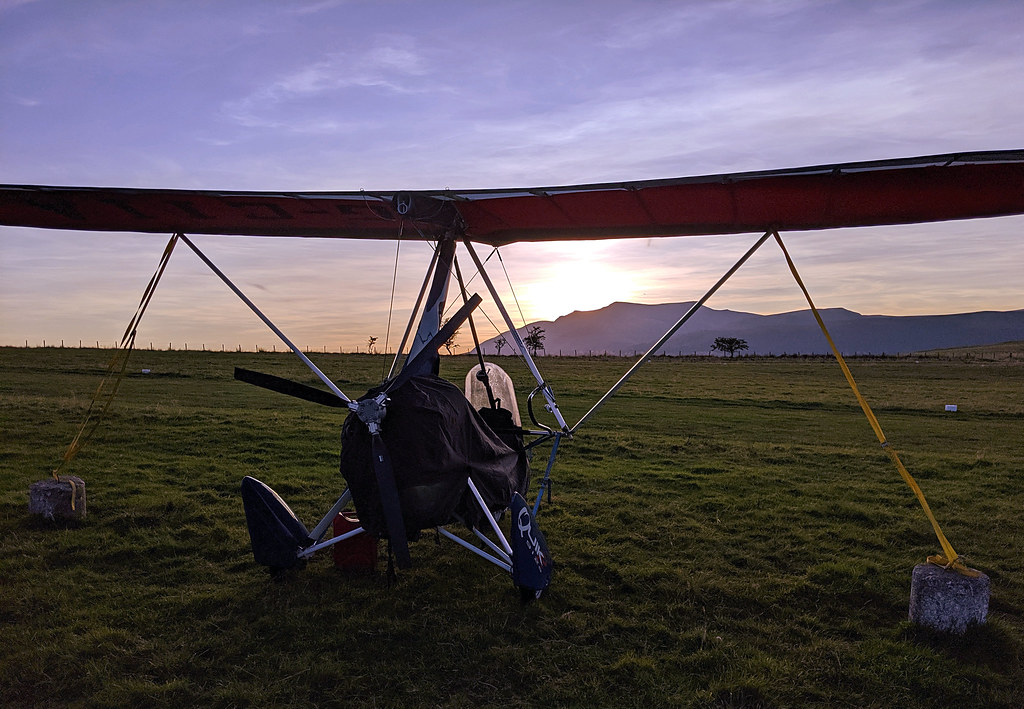 The trike gazes out on the sunset over Blencathra