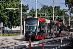 Sydney Light Rail - LRVs 011 & 012  approach Moore Park stop (john cowper) Tags: sydneylightrail cselr moorepark alstom citadisx05 construction altrac transportfornsw transdev drivertraining testing lrv011 lrv012 lrv027 lrv028 lrv023 lrv024 lrv037 lrv038 sydney newsouthwales