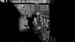 Street (MJ Black) Tags: liverpool liverpoolstreetphotography mono monochrome monochromephotography merseyside north northwest people peoplephotography portrait portraits candid candidphotography street streetphoto streetphotograph streetphotography streets streetscene streetportrait shadows shadow highcontrast blackandwhite blackandwhitephotography bw bwphotography x100f 23mm fuji fujix100f fujifilmx100f fujifilm f8 bike bicycle