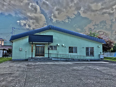 Community Center, variant (sjrankin) Tags: 20september2019 edited kitahiroshima hokkaido japan neighborhood communitycenter showastyle clouds parkinglot