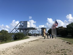 A View Toward Pegasus Bridge (Melinda * Young) Tags: flags history wwii invasion dday normandy pegasus bridge memorial park tourists touring