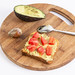 Avocado on the bread with sliced tomato