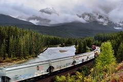 I Have Waited for This Day for a Long Time!  (Banff National Park) (thor_mark ) Tags: albertaprovincialhighwayno1a alongbanksofbowriver atmorantscurve banffnationalpark banfflakelouisecorearea bowrange bowriver bowvalleyparkway canadianpacificrailway canadianpacificrailwaytrack canadianrockies capturenx2edited cloudsswirlingaround cloudsacrossvalley cloudsaroundmountains colorefexpro continentaldivide day4 engine evergreens fairviewmountain freighttrain hillsideoftrees hillsides landscape locomotive longstretchoftrain lookingwest lookingtocontinentaldivide lookingtomountainsofthecontinentaldivide lowclouds morantscurve mostlycloudy mountainvalley mountains mountainsindistance mountainsoffindistance nature nikond800e outside overcast portfolio project365 railline railroad railroadtracks railwaytracks river riverbank rockymountains saddlemountain sheolmountain southerncontinentalranges train traincars trainengine traingoingby trainlocomotive traintracks traininmotion trees triptoalbertaandbritishcolumbia alberta canada