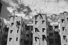 (a.pierre4840) Tags: olympus om2sp zuiko f2 jchstreetpan400 35mmfilm architecture urban decay 35mm bw blackandwhite noiretblanc kowloon hongkong shadows clouds sky