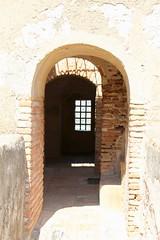 Albarrana Tower (Piedmont Fossil) Tags: malaga spain mount gibralfaro castle fort fortress window bars