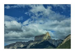 against the clouds (Armin Fuchs) Tags: arminfuchs nomansland mountains sky clouds blue anonymousvisitor thomaslistl wolfiwolf jazzinbaggies montaiguille autumn
