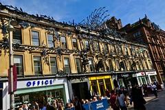Princes Square, Glasgow, UK (Robby Virus) Tags: glasgow scotland uk unitedkingdom britain greatbritain gb princes square peacock sculpture ivy vines leaves iron shopping center building facade