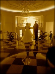 Exit (Turbo666) Tags: sepia exit event setting vouyeur beautiful woman over shoulder checkerboard reflection collection autograph bride wedding groom