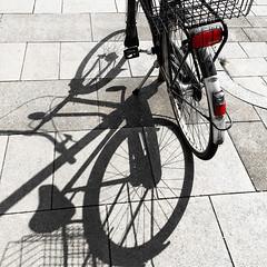 the shadow (j.p.yef) Tags: bicycle shadow monochromeplusred square street sun peterfey jpyef yef selectivecolor elitegalleryaoi bestcapturesaoi aoi