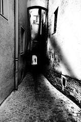 .... narrow alley .... (christikren) Tags: absoluteblackandwhite christikren alone dark narrowalley gasse schmal man candid shadows light panasonic photography wall street streetphotography urban mood loweraustria human shade streetview person walk
