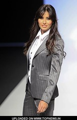 Elisabetta Gregoraci (kurcha_bellya) Tags: elisabetta gregoraci model walks runway presentation new bridal collection by raimon bundo 34 length shot grey pants gray jacket white vest tie shirt long wavy brown hair brunette restrictions worldwide syndication rights except spain no in orientation portrait face count 1 barcelonaspain