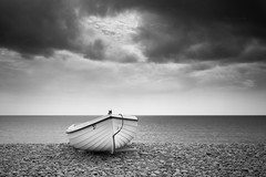 leaden... (Vladimir Barvinek) Tags: blackandwhite monochrome devon budleighsalterton sea view young herringgull boat beach shore pebbles seafront weather heavy overcast leaden dark sky clouds