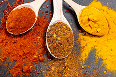 Fragrant spices. Ground paprika, turmeric and a mixture of peppers in wooden spoons (wuestenigel) Tags: spice asian spoon aromatic wooden old pepper vintage chili background red spices indian paprika food colorful spicy seasoning powder turmeric curry black natural cuisine yellow ingredient kitchen pulver kurkuma würzen pfeffer noperson keineperson ginger ingwer cumin kreuzkümmel cardamom kardamom condiment würze cilantro koriander dry trocken desktop aromatisch löffel cinnamon zimt hot heis cooking kochen saffron safran 2019 2020 2021 2022 2023 2024 2025 2026 2027