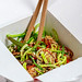 Japanese food: Soba noodles with mushrooms, broccoli, carrots, peppers close-up with chopsticks